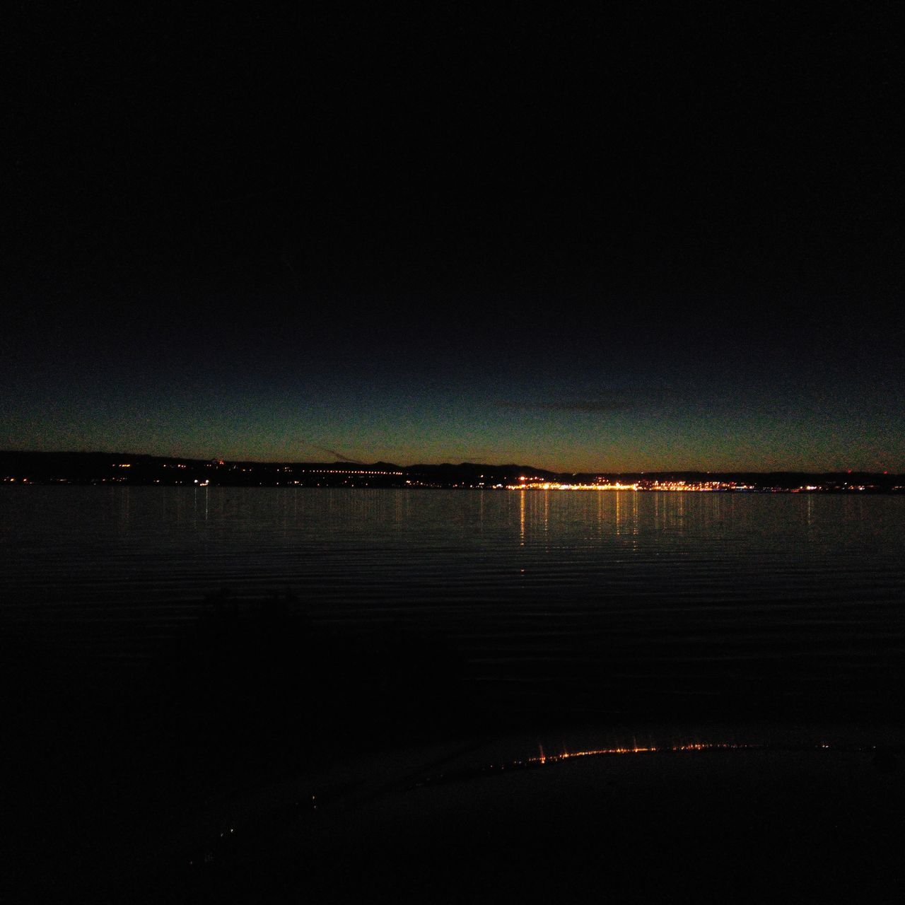 water, nature, scenics, tranquil scene, reflection, beauty in nature, tranquility, night, outdoors, no people, sky, lake, waterfront, silhouette, illuminated, clear sky