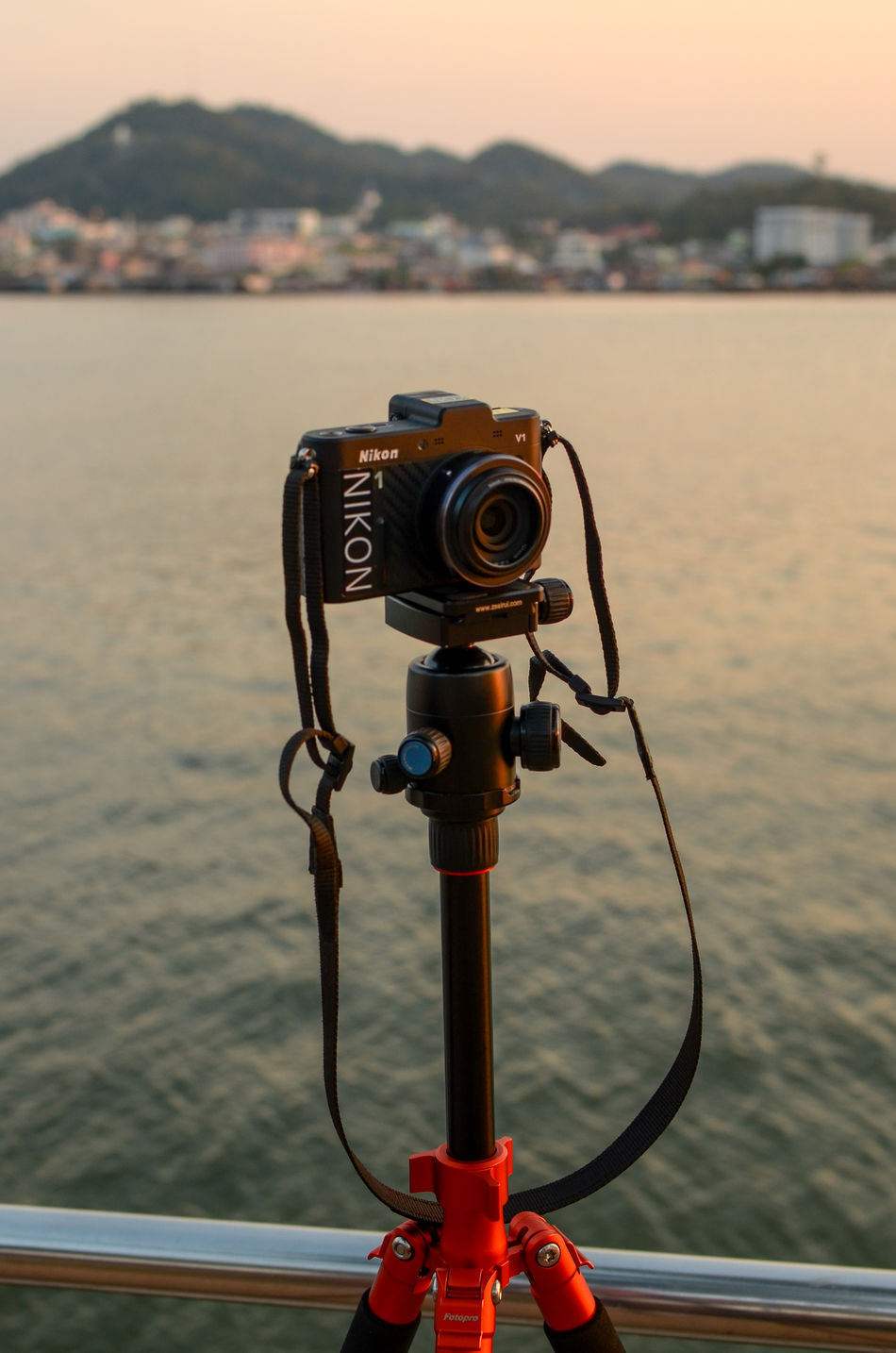 Digial camera on tripod with blured background (Nikon 1 V1 camera) Blurred Background Camera - Photographic Equipment Dusk Equipment Hobbies Memories Mountain Nikon Nikon 1  Nikon 1 V1 Nikon V1 Outdoors Photography Photography Themes Scenics Sea Sky Sunset Tourism Tourist Travel Travel Tri Pod View Water