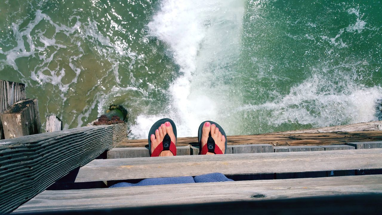 Red White Blue Sandle Feet Pier Railing Peeking Looking Observe Observing Seeking Interested Watching Finding Find Waves Copyspace Background Meditation Pattern The Street Photographer - 2017 EyeEm Awards The Great Outdoors - 2017 EyeEm Awards Water Tranquility Live For The Story