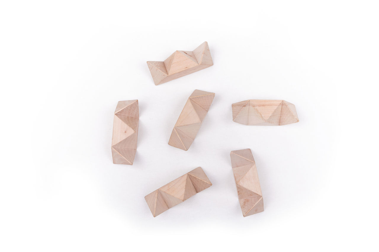 High Angle View Of Wooden Toys Over White Background