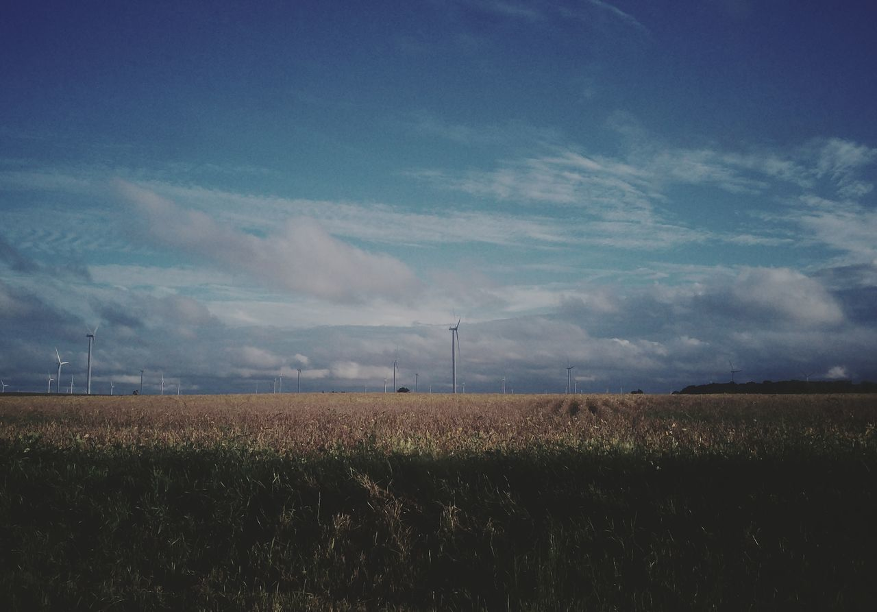 field, landscape, rural scene, sky, agriculture, wind turbine, nature, wind power, tranquil scene, beauty in nature, cloud - sky, tranquility, scenics, no people, day, windmill, outdoors, alternative energy, industrial windmill, grass