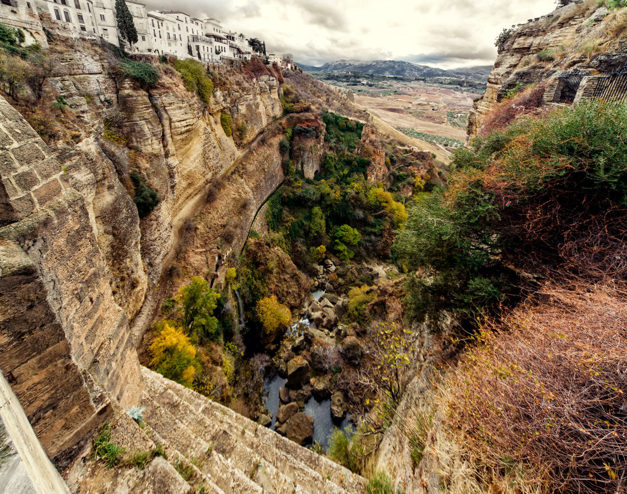 Amazing view of the Ronda canyon and the famous white village. Province of Malaga, Andalusia, Spain Amazing Nature Ancient Architecture Andalusia Canyon Cliffs Costa Del Sol Europe Famous Place Gorge Guadalevin History Landmark Landscape Malaga Nature Outdoors Picturesque Village Rocky Mountains Ronda Spain Scenery SPAIN Stunning Scenery Town Travel Destinations Village
