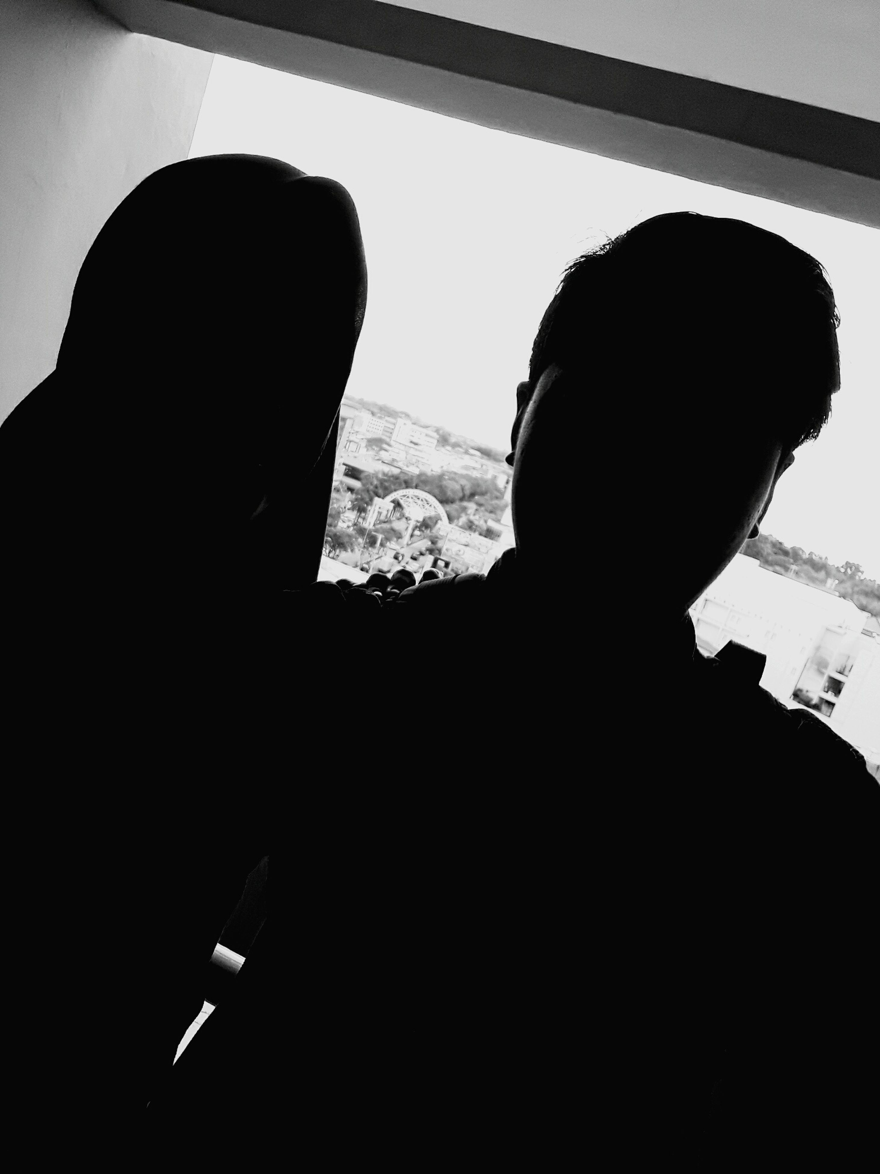 two people, silhouette, real people, leisure activity, lifestyles, adults only, men, people, only men, indoors, adult, togetherness, day, human body part