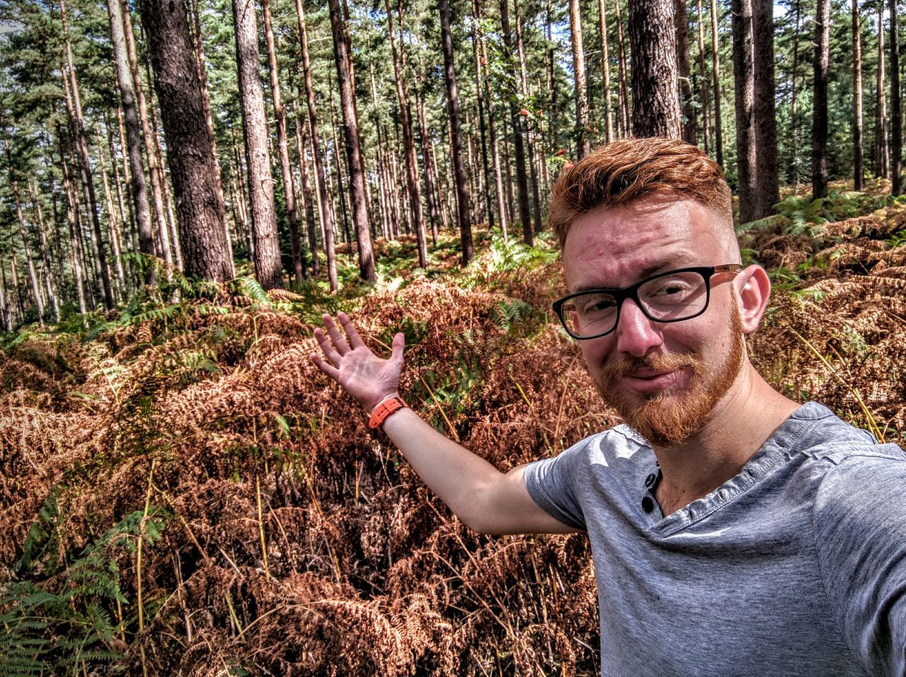 forest, tree, nature, one person, tree trunk, outdoors, young adult, woodland, casual clothing, day, real people, scenics, beauty in nature, smiling, portrait, one man only, adults only, adult, people, only men