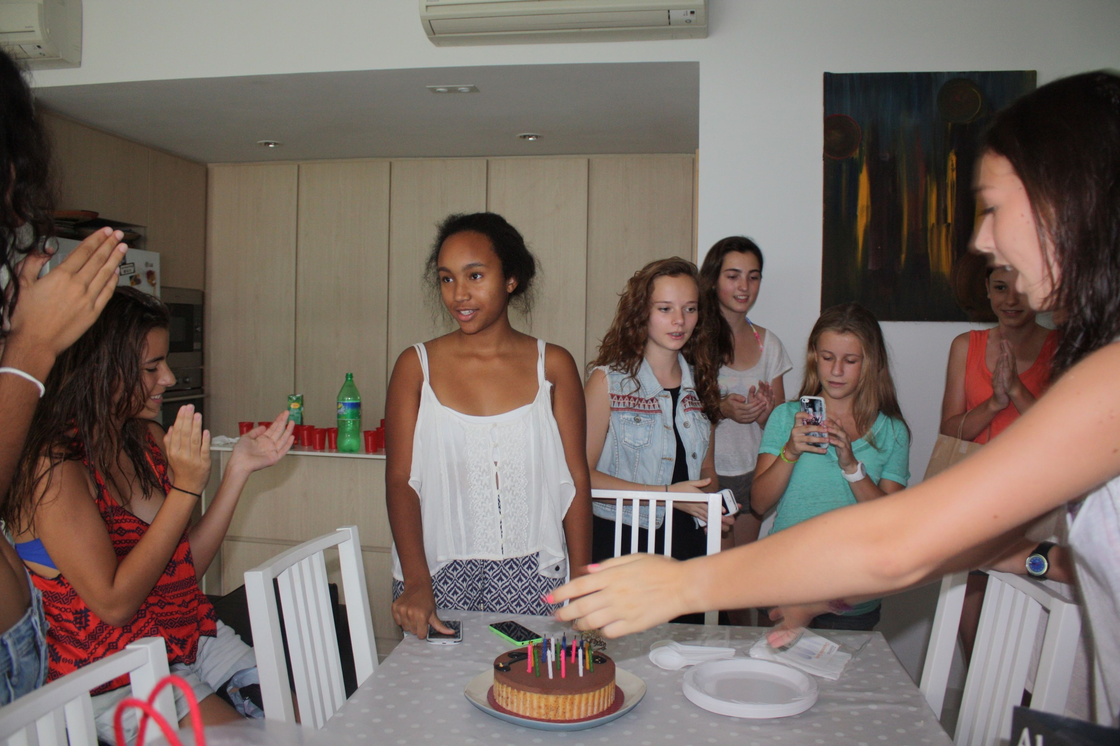 indoors, lifestyles, young adult, leisure activity, person, casual clothing, sitting, young women, front view, food and drink, holding, smiling, togetherness, happiness, table, looking at camera