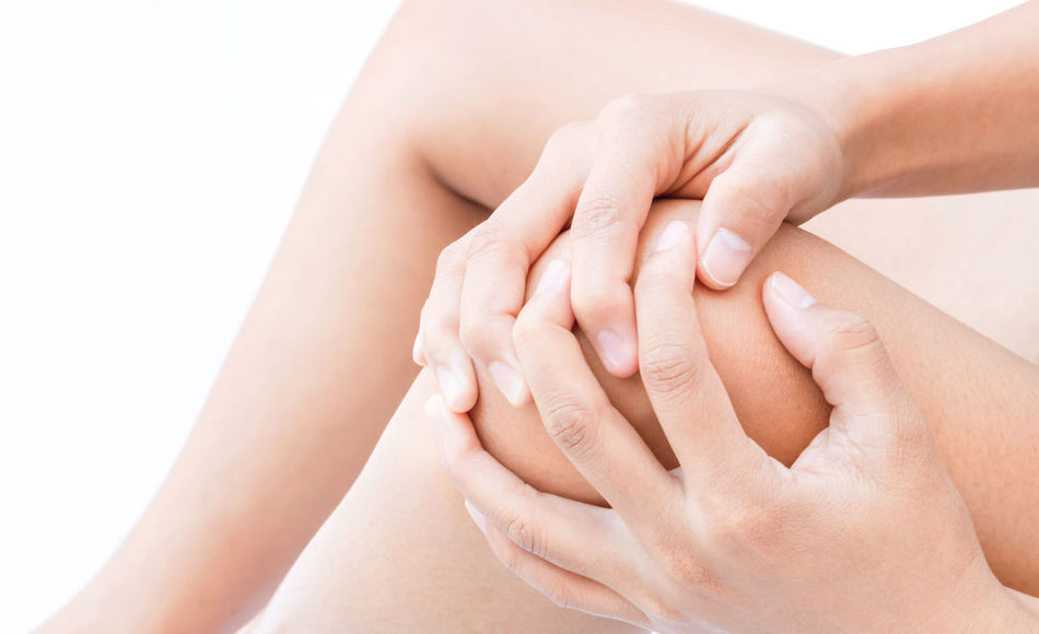 Closeup woman hand hold knee with pain symptom, health care and medical concept Body Care Close-up Health Care Human Body Part Human Finger Human Hand Human Skin Knee Knees Moisturizer Pain Pampering Touching White Background Women Young Adult