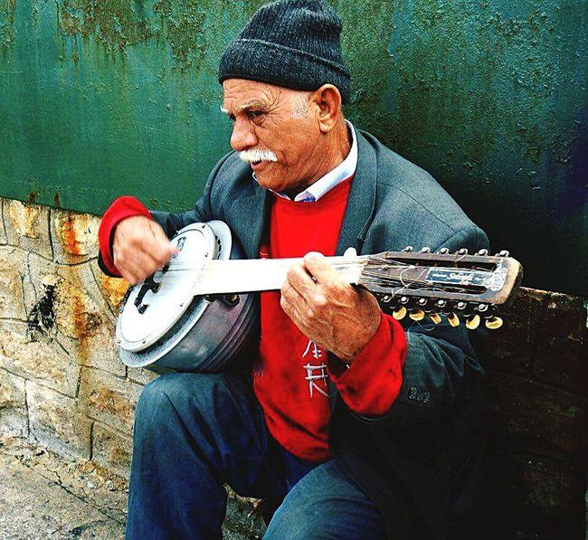 The Portraitist - 2016 EyeEm Awards Oldman Old Music Musician Musicians Portait Of A Men Men Man Color Colorful Colorful Photo
