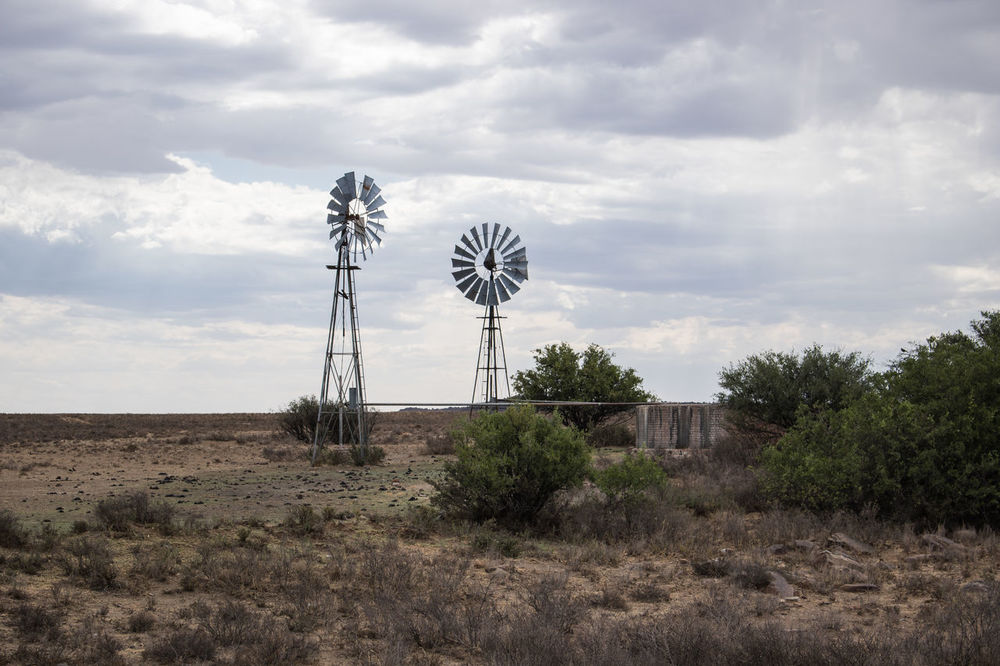 Architecture Built Structure Clear Sky Day Distant Environmental Conservation Karoo Karooheartland No People Outdoors Remote Sky Tower Tranquil Scene Tree Windmill