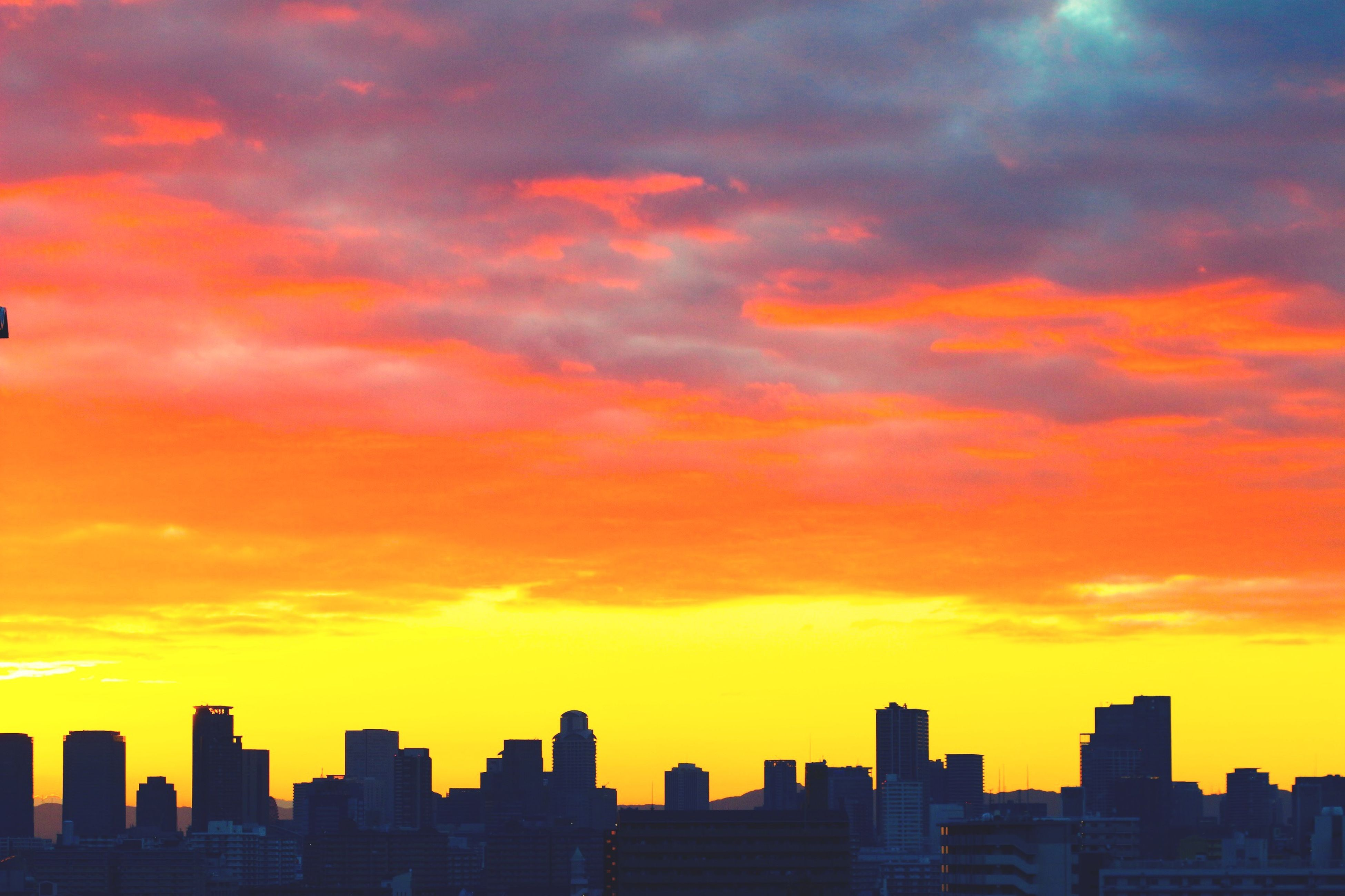 sunset, building exterior, architecture, city, built structure, orange color, cityscape, sky, skyscraper, silhouette, cloud - sky, urban skyline, skyline, cloud, tower, scenics, tall - high, dramatic sky, beauty in nature, building