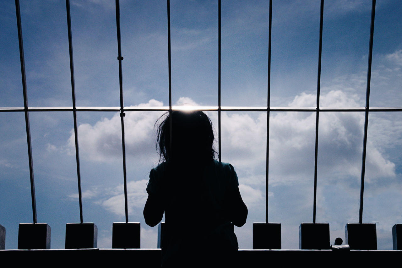 Waist Up Rear View One Person Sky Silhouette People Architecture Dream Wonder Curiosity Curious Peek Peeking Rebel Jail Cage Caged Caged Freedom Caged Life Freedom