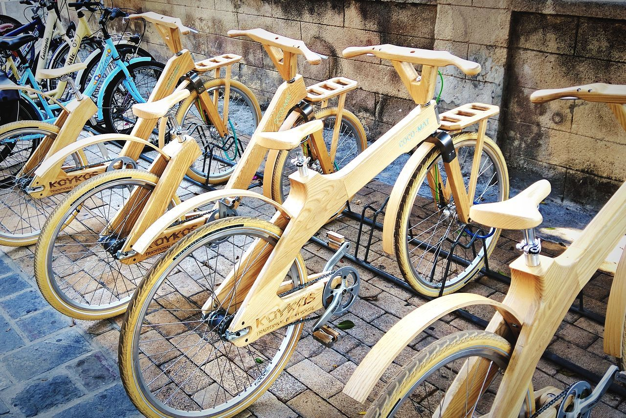 CyclingUnites Bicycle Transportation Mode Of Transport Land Vehicle Parking Stationary Outdoors No People Day Bicycle Rack Horizontal Wooden Bike Wood Wood Material