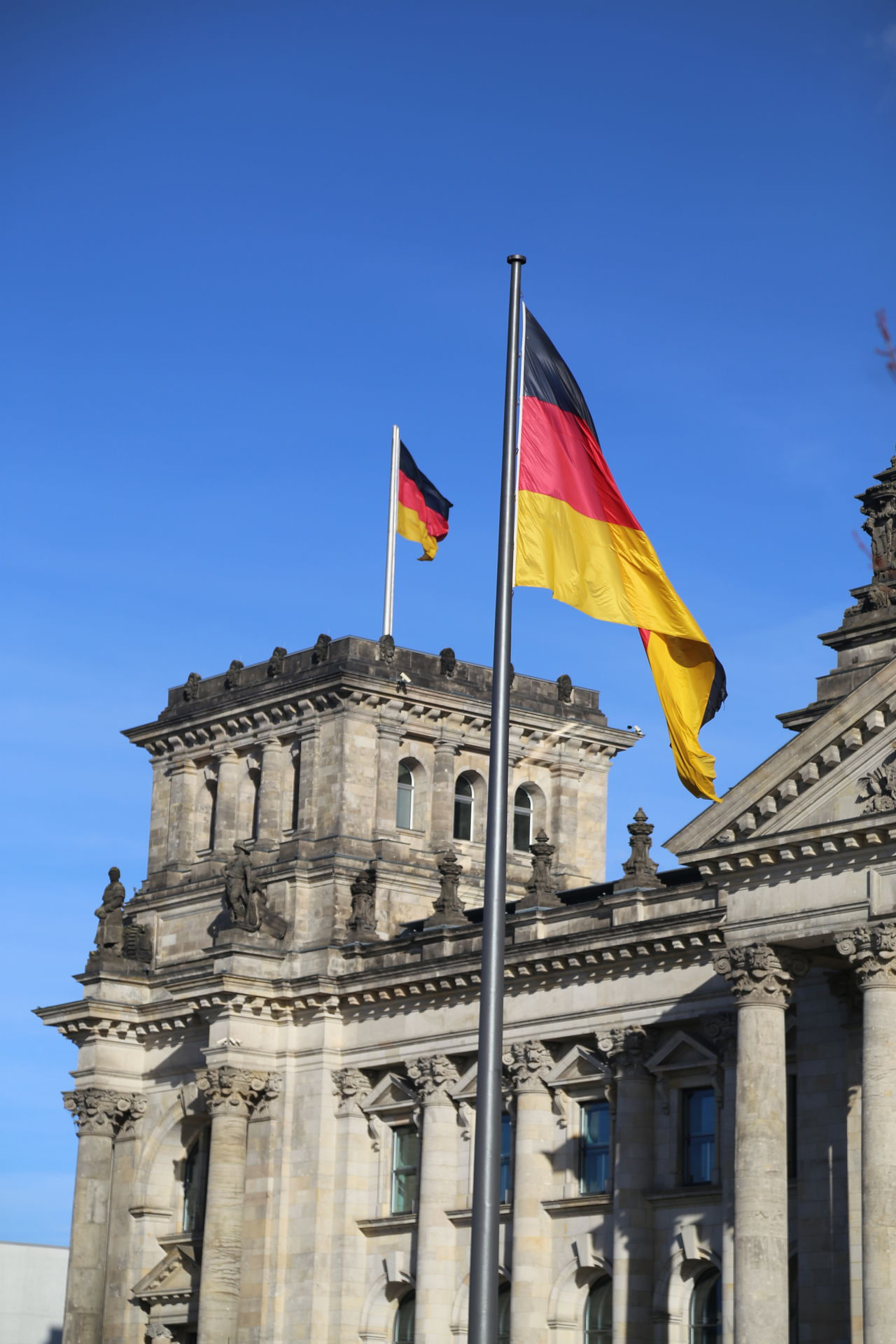 Architecture Black Red Gold Building Exterior Built Structure City Clear Sky Day Flag German Flags Government Low Angle View No People Outdoors Patriotism Politics And Government Reichstag Building Sky Tourism Travel Travel Destinations