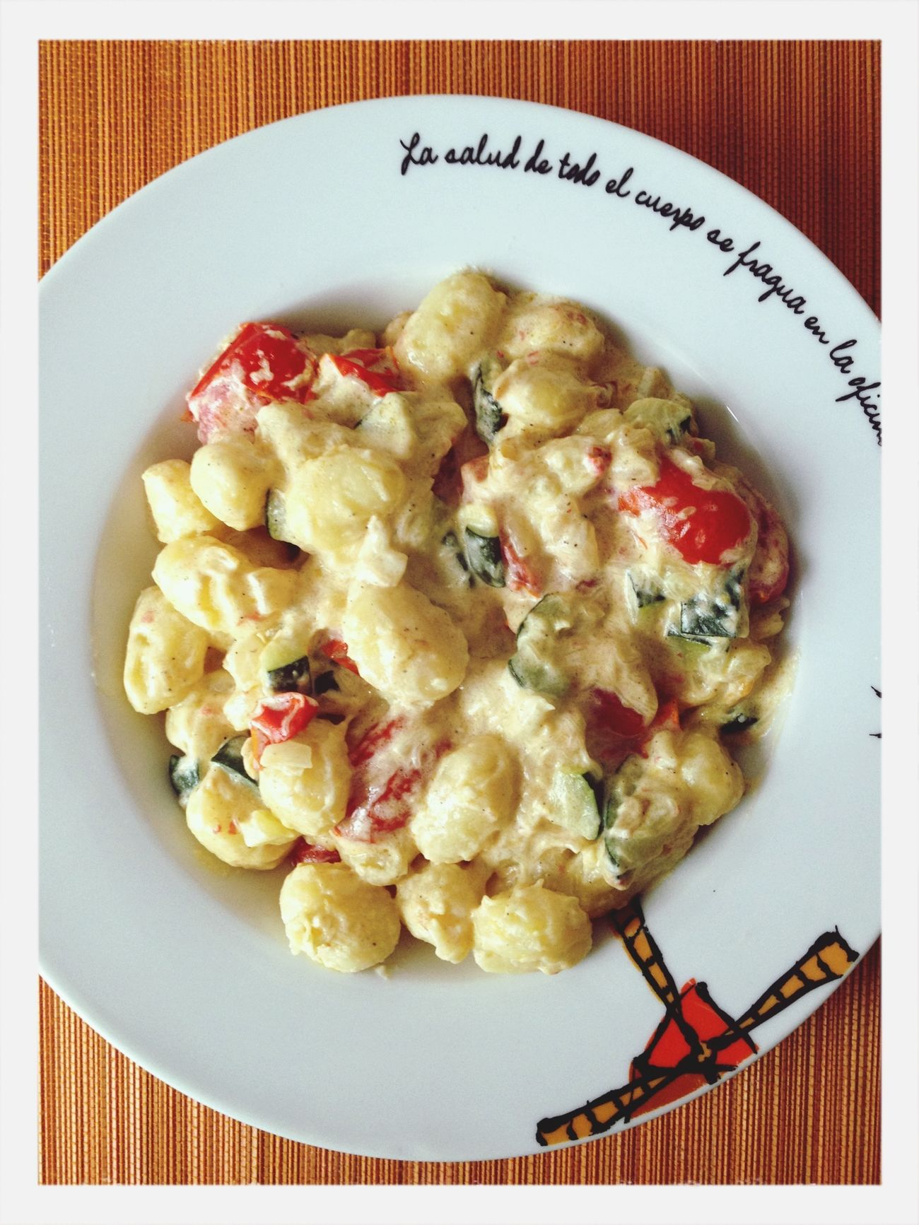 Gnoccis with sauteed vegetables (cherry tomatoes, onion and zucchini) and cream. Food Vegetarian Food Italian Food Gnocci