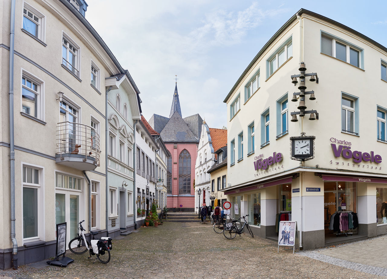 KEMPEN, GERMANY - OCTOBER 26, 2016: The central church resides between narrow lanes Atmospheric Mood Christanity Colorful Downtown Germany Heritage High Resolution Historic City History Light Love Market Medieval Outdoors People Relaxing Shopping Travel Destination Urban