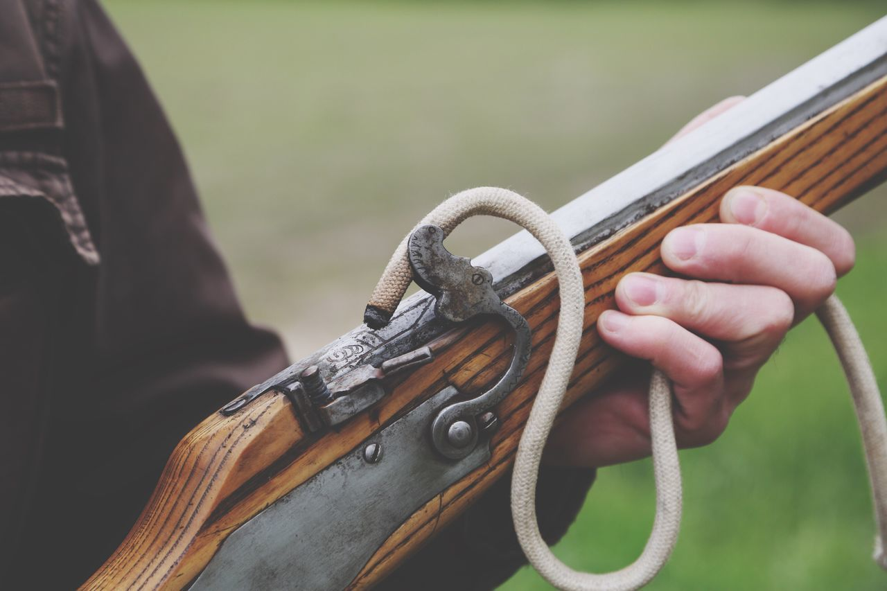 Firing an old rifle Human Hand Human Body Part Focus On Foreground One Person Outdoors Close-up Day Holding Real People People Gun Old Vintage Rifle Firing