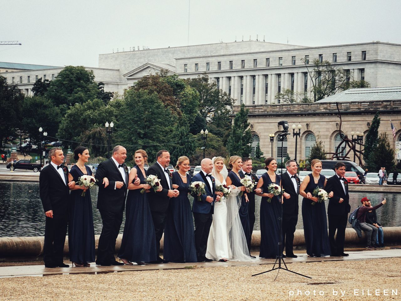 large group of people, real people, men, architecture, building exterior, standing, built structure, full length, day, outdoors, togetherness, ceremony, tree, women, well-dressed, sky, young women, young adult