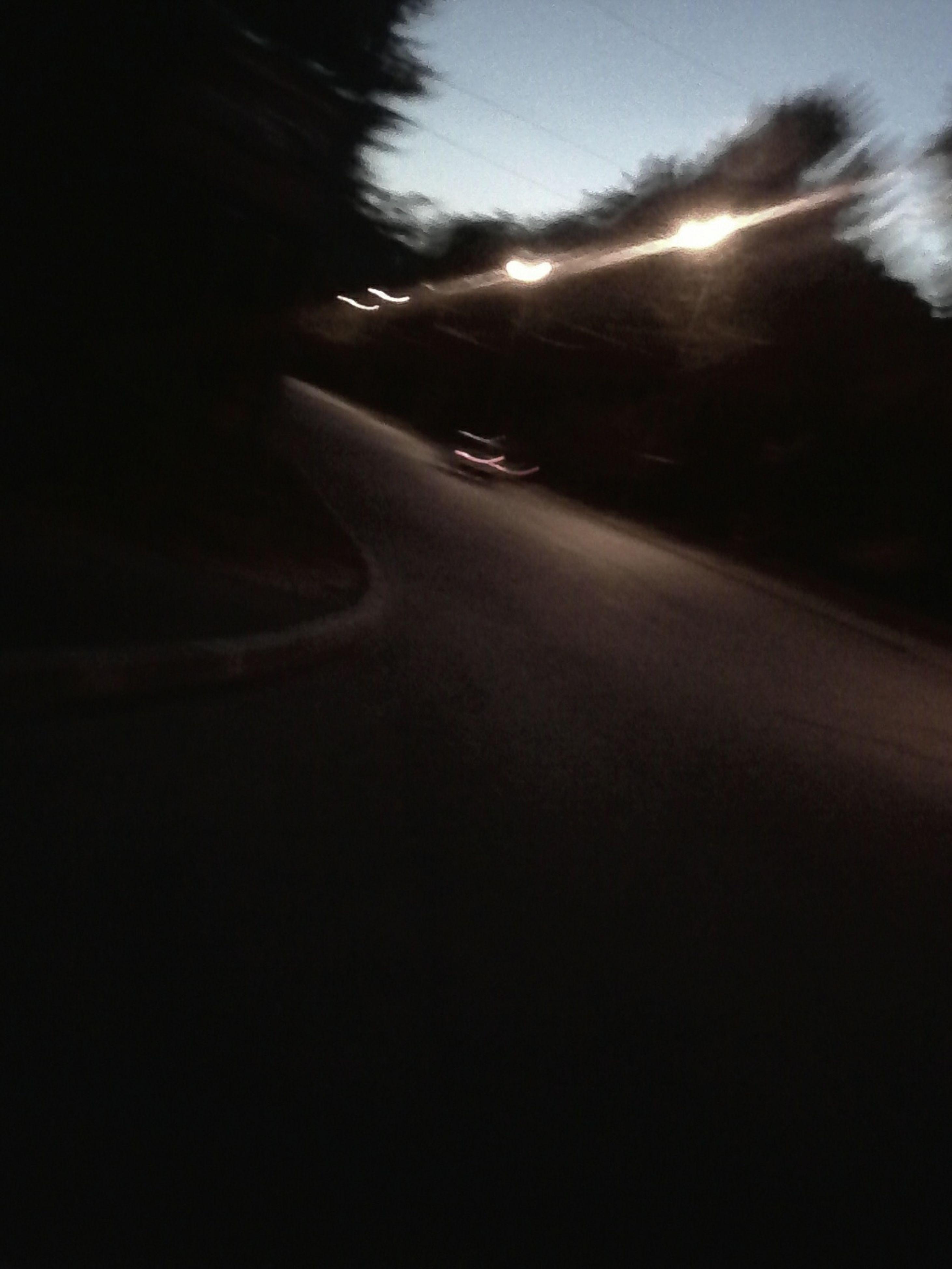 transportation, road, the way forward, street, car, road marking, night, illuminated, mode of transport, land vehicle, diminishing perspective, vanishing point, sky, street light, asphalt, silhouette, outdoors, on the move, no people, dusk