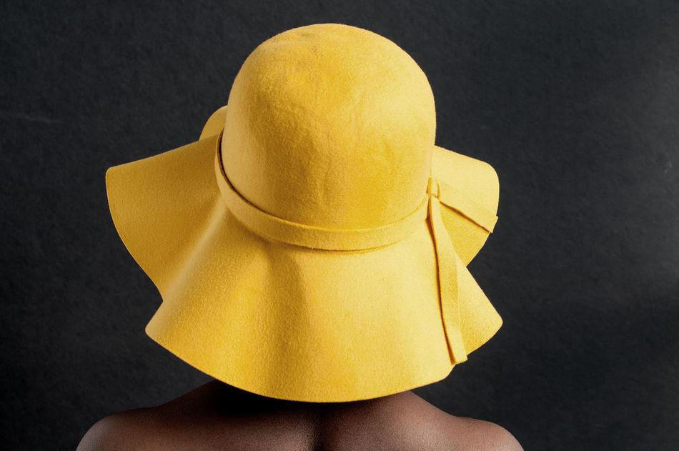 Got my sunny hat on! Black Background Close-up Eye4photography  EyeEm Best Shots EyeEm Best Shots -People + Portrait EyeEm Gallery Hat Minimalism Portrait Of A Woman Women Around The World Yellow