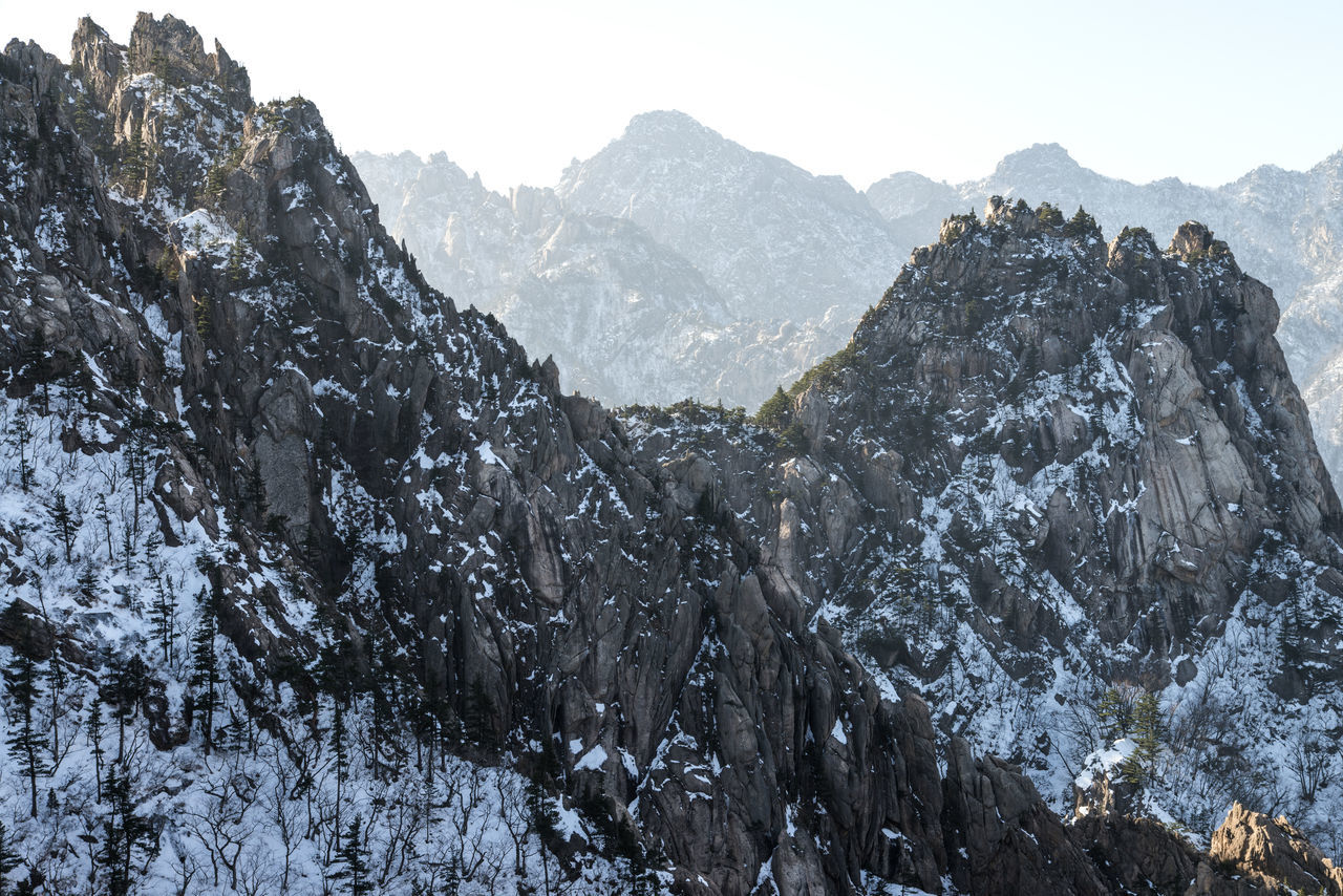 Winter in Mountain Seorak, South Korea Beauty In Nature Cold Temperature Day Frozen Low Angle View Mountain Mountain Range Mountain Seorak Nature No People Outdoors Rock Rocky Scenics Seoraksan National Park Sky Snow Tranquil Scene Tranquility Tree Winter