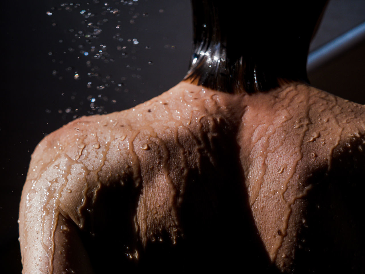 Black Background Close-up Glittering Human Body Part Human Hand Motion One Person People Shirtless Shower Splashing Studio Shot Water Young Adult