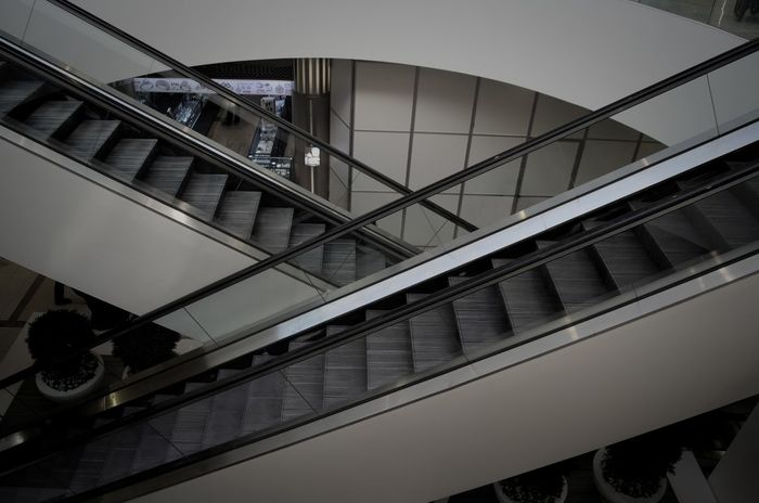 Architecture Built Structure City Day Indoors  Low Angle View Men Modern One Person People Railing Real People Sky Staircase Steps Steps And Staircases Transportation Travel
