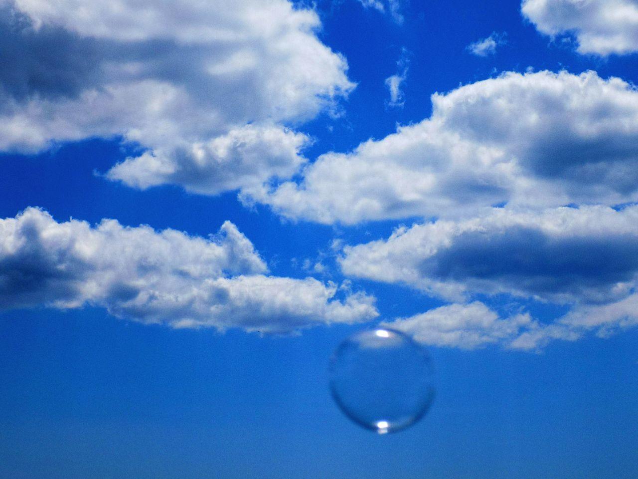 Bubble Against Blue Cloudy Sky