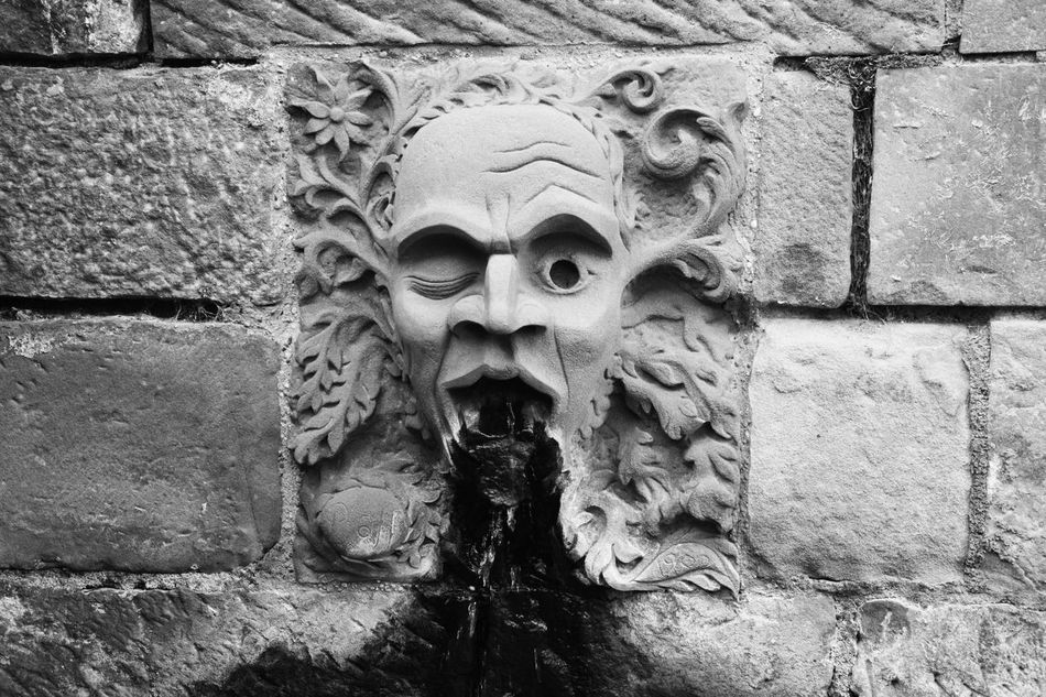 The demon face Architecture Art Art And Craft Black & White Black And White Black And White Collection  Black And White Photography Black&white Blackandwhite Blackandwhite Photography Blackandwhitephotography Built Structure Creativity Demon Face Fountain Historic History Human Representation Statue Stone Material Wall Wall - Building Feature Monochrome Photography