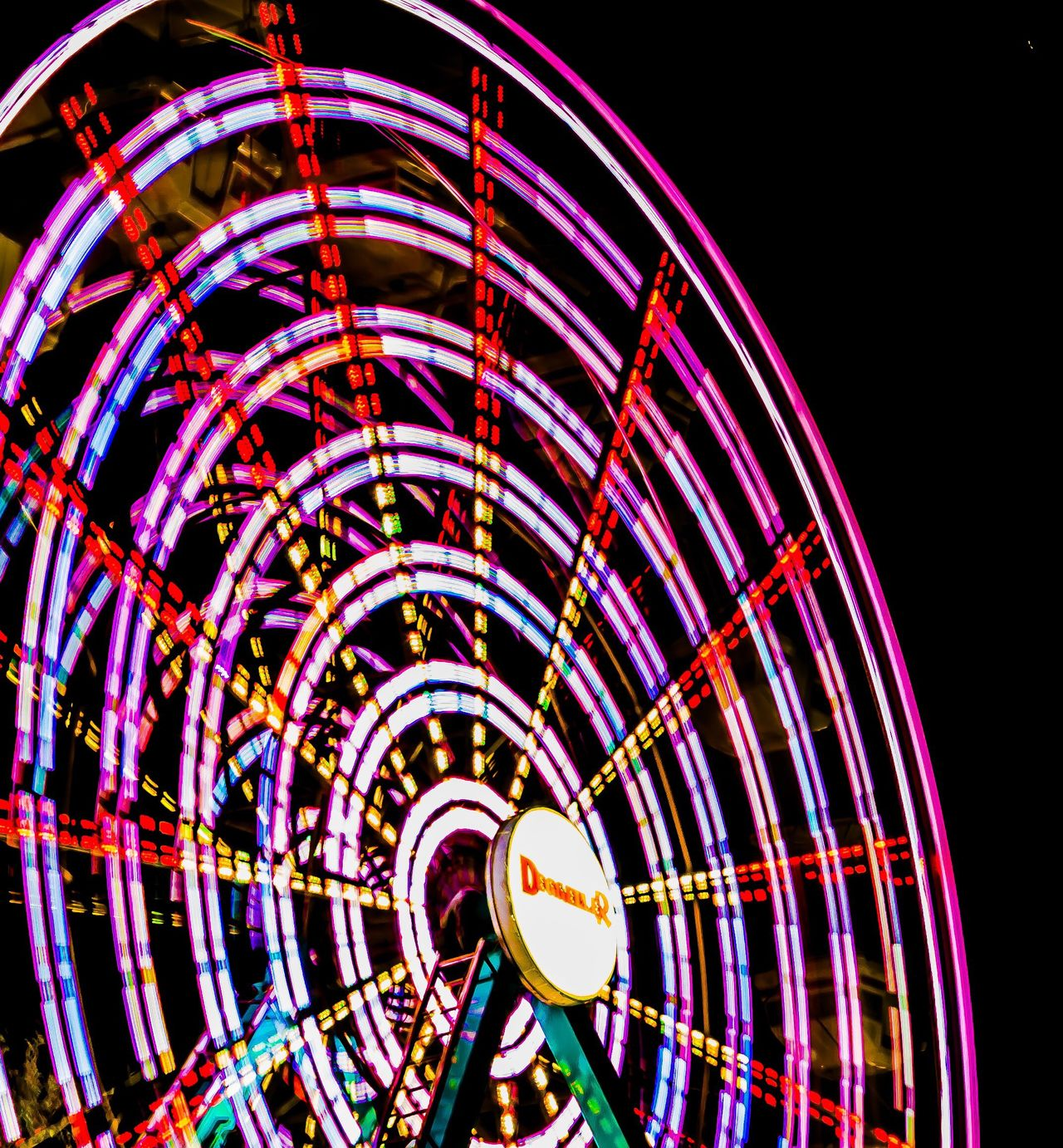 Illuminated Night Low Angle View Amusement Park No People Clear Sky Amusement Park Ride Motion Outdoors Architecture Abstract Photography EyeEm Best Shots EyeEm Gallery Light Effect Blurred Motion Long Exposure Nightphotography Spinning Abstract Speed Big Wheel Ferris Wheel Multi Colored Eyeemphotography EyeEm