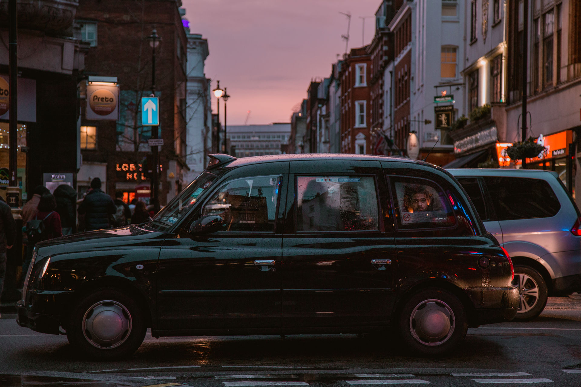 cruising down Soho streets moody Light Lights street photography street one man only City Life City city lights neon dusk evening dusk in the city one person Transportation people in transit Transit car Road London sunset Shades of Winter An Eye For Travel