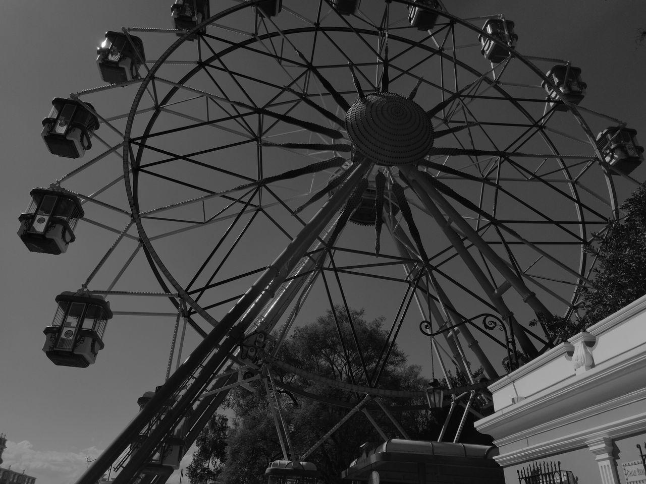 amusement park, arts culture and entertainment, amusement park ride, low angle view, fairground ride, leisure activity, ferris wheel, big wheel, sky, outdoors, no people, day, clear sky, carousel