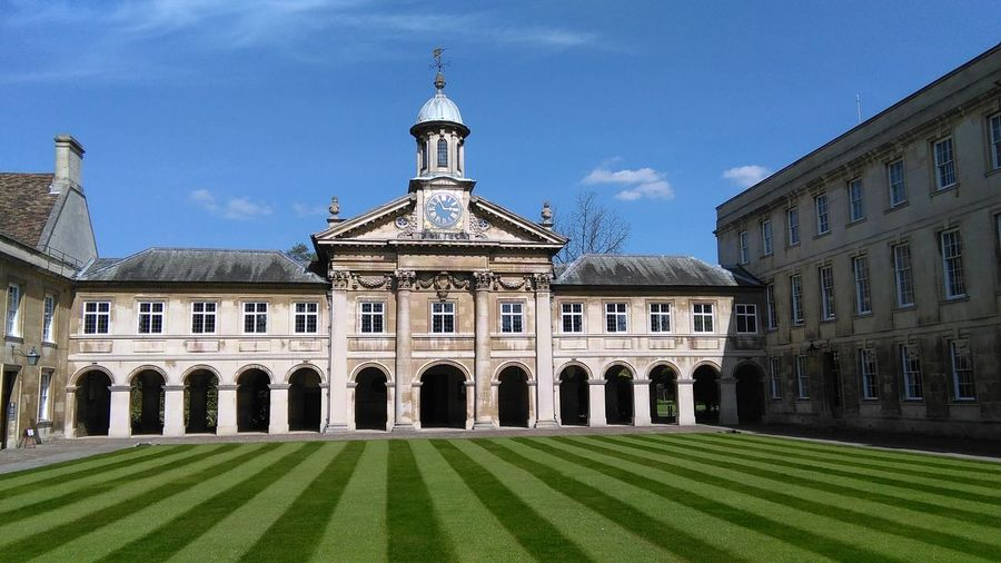 Cambridge Cambridgeshire University Campus Grass Sky Day Outdoors Travel Destinations Building Exterior Architecture Architectural Column Lawn Holiday Cambridge, United Kingdom Green Color Grass