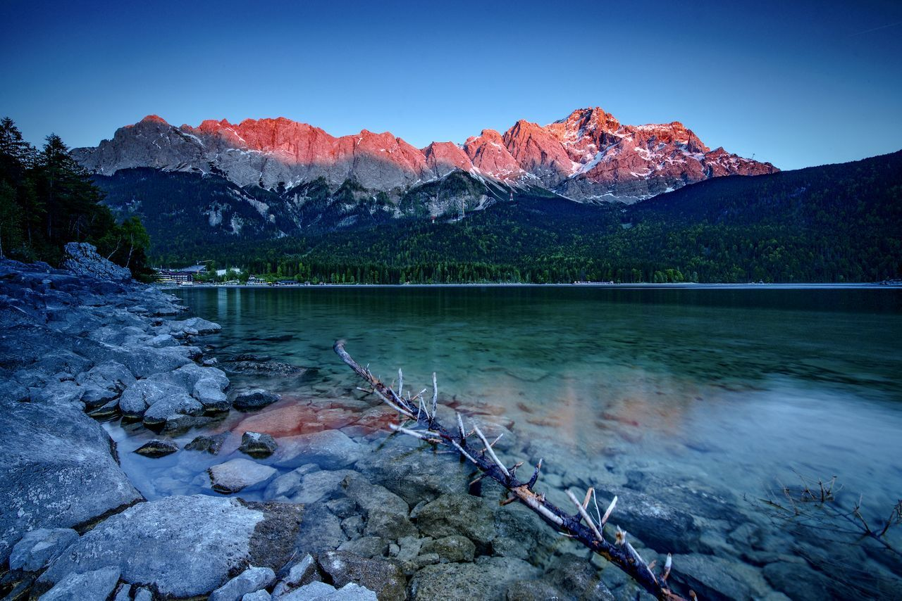 Alps Bavaria Bayern Beauty In Nature Clear Sky Eibsee Forest Lake Landscape Mountain Mountain Range Nature No People Outdoors Rock - Object Scenics Sky Tranquil Scene Tranquility Travel Destinations Tree Water Winter Zugspitze