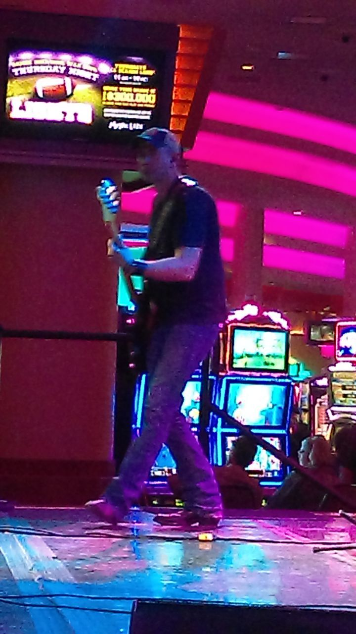 illuminated, night, indoors, nightlife, arts culture and entertainment, leisure activity, nightclub, real people, lifestyles, men, one person, full length, neon, people, adult