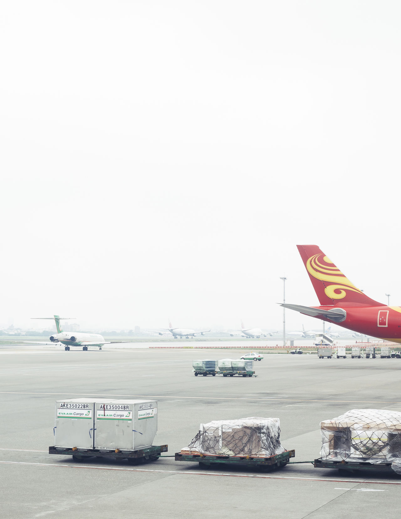Taipei Airport Aerospace Industry Air Vehicle Airplane Airport Airport Runway Boarding Business Business Finance And Industry Cargo Cart Day Fog Foggy Day Foggy Morning Goods Minimal No People Platform Post Transport Transportation Transportation Travel Travel Photography Traveling