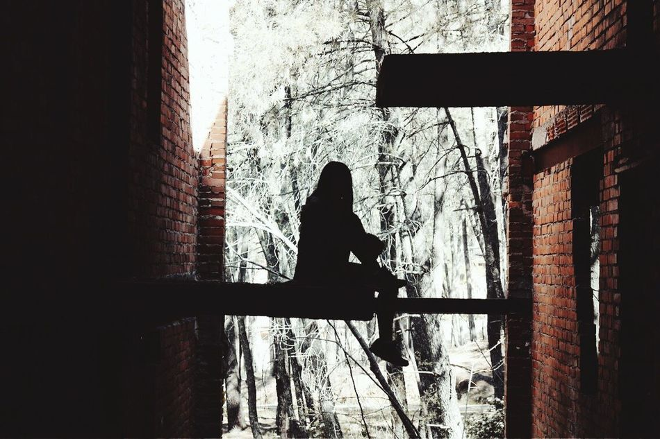 Dark Silhouette Real People Bare Tree Building Exterior Architecture One Person Built Structure Day Leisure Activity Lifestyles Outdoors Cold Temperature Shadow Full Length Women Tree Branch Nature Sky LOWLIGHT