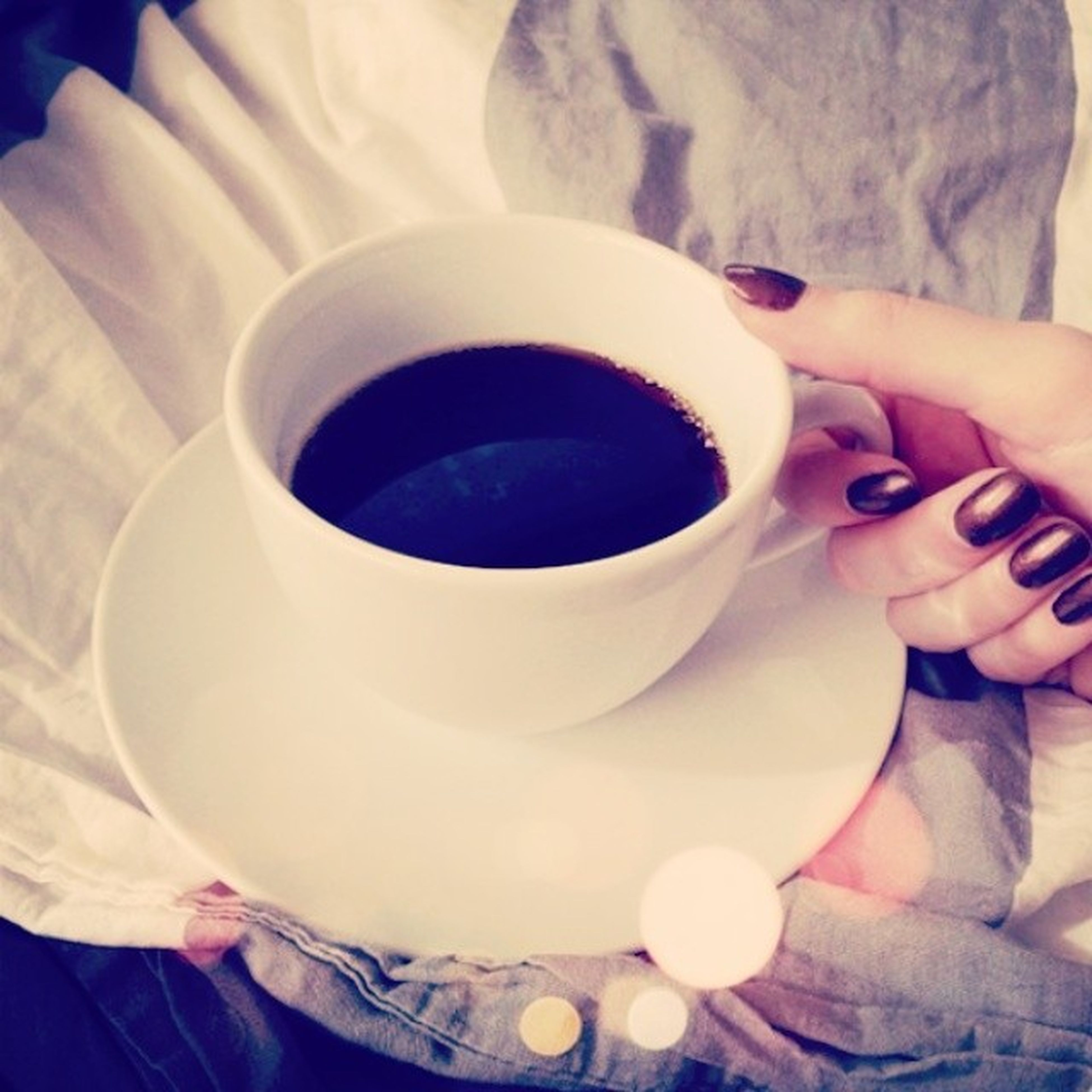 drink, coffee cup, refreshment, indoors, food and drink, coffee - drink, person, cup, freshness, coffee, saucer, lifestyles, holding, unrecognizable person, part of, leisure activity