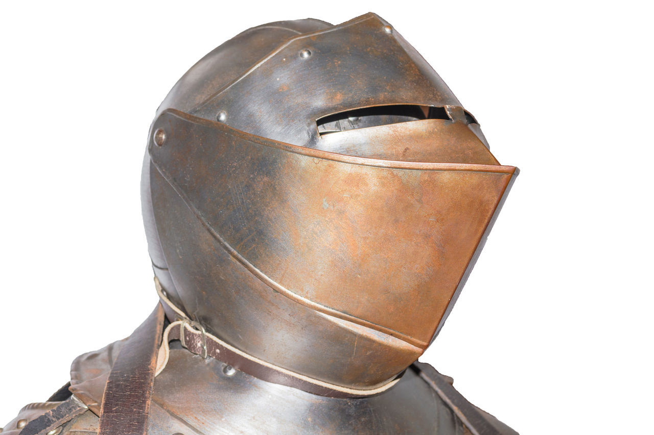 An antique European knight armor isolated against white background. Antique Armor Body Armor Brown Guard Historic Knight  Knight Armor Mediaeval Medieval Metal Musical Instrument No People Old-fashioned Plate Harnisch Ship Single Object So Suit Suit Of Armor Sword Traditional Armor Weapon White Background