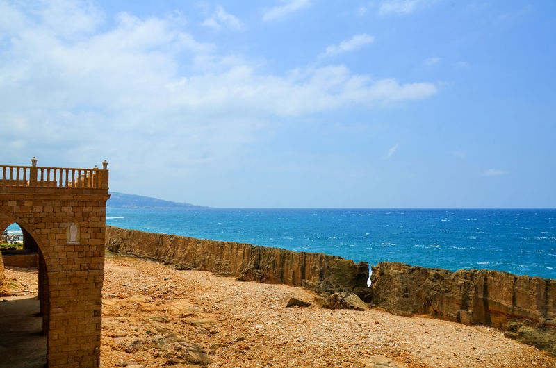 Beach Beauty In Nature Historic Historical Sights Natural Phoenician Phoenician Sea Wall Port Rock Rock Formation Sea Sea Wall Walll