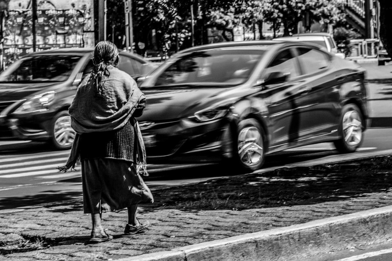 transportation, car, real people, full length, mode of transport, land vehicle, one person, outdoors, day, road, lifestyles, tree, men, women, people