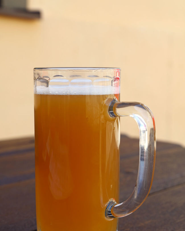 A glass of unfiltered wheat (weizen) beer on wooden table Ale Beer Beverage BIG Brewery Close-up Culture Drink Europe Food And Drink Freshness Frothy Drink Full Glass One Personal Perspective Refreshment Serving Size Table Time Traditional Unfiltered Weizen Weizenbier Wheat