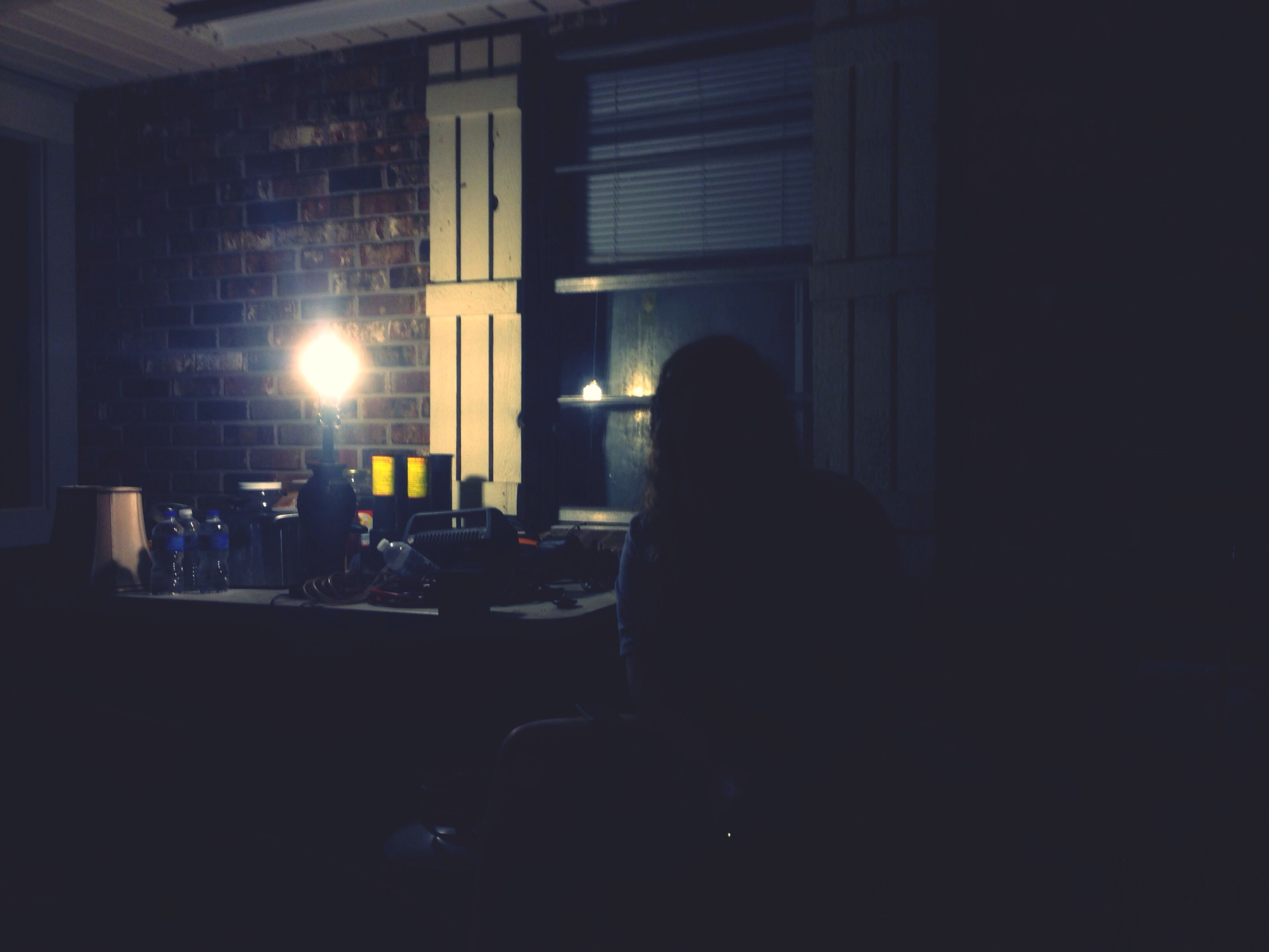 indoors, men, sitting, window, lifestyles, rear view, leisure activity, architecture, person, built structure, chair, silhouette, dark, illuminated, side view, transportation, unrecognizable person