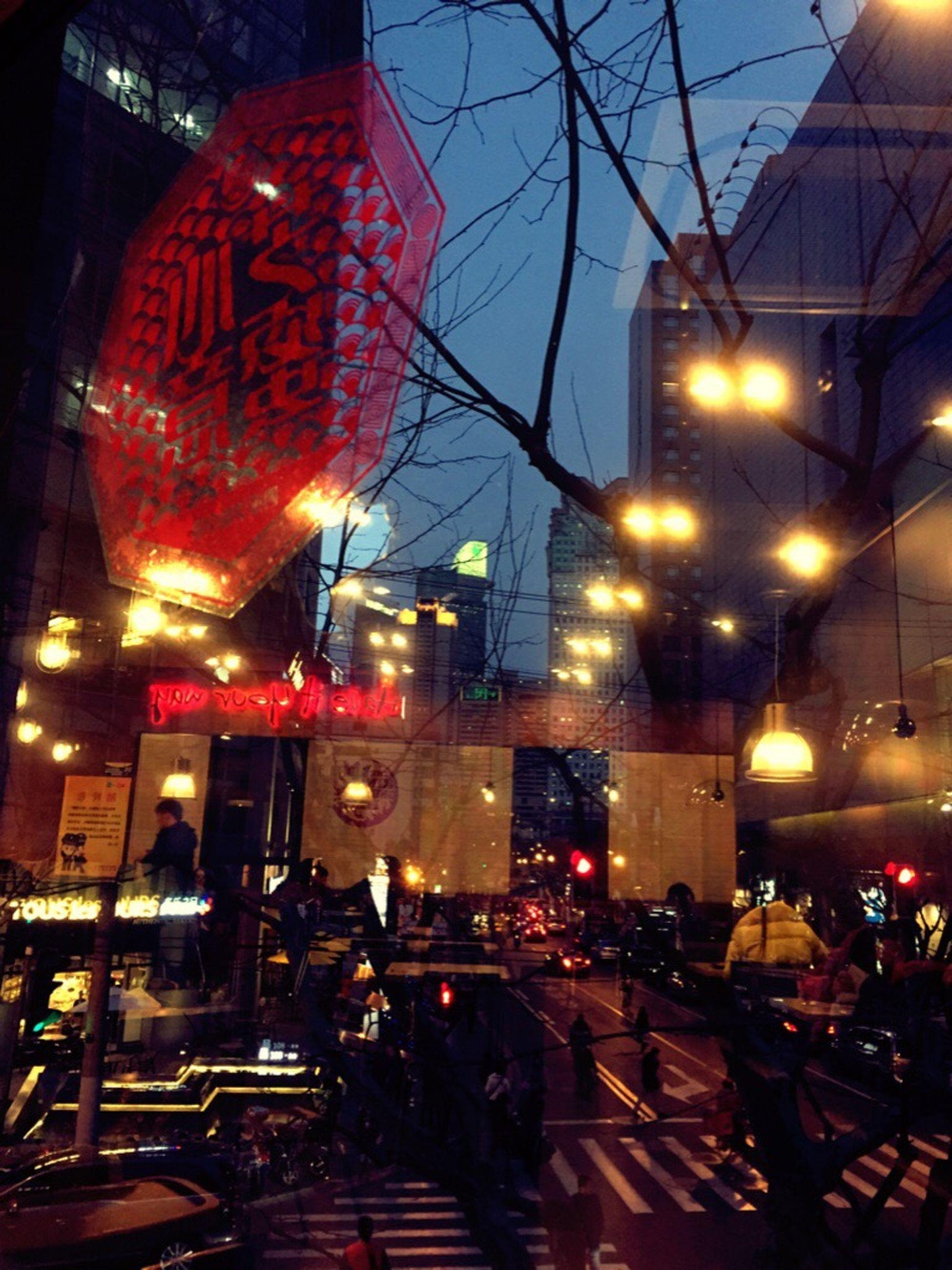 illuminated, building exterior, night, street, city, architecture, street light, built structure, lighting equipment, land vehicle, car, transportation, city street, city life, road, dusk, mode of transport, incidental people, sky, outdoors