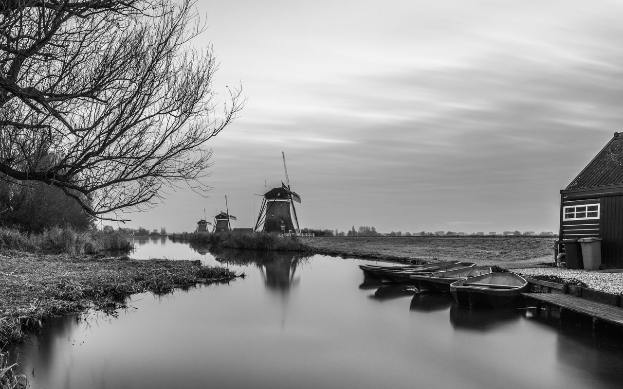 architecture, built structure, building exterior, sky, water, no people, place of worship, spirituality, outdoors, nature, day, bare tree, beauty in nature, windmill