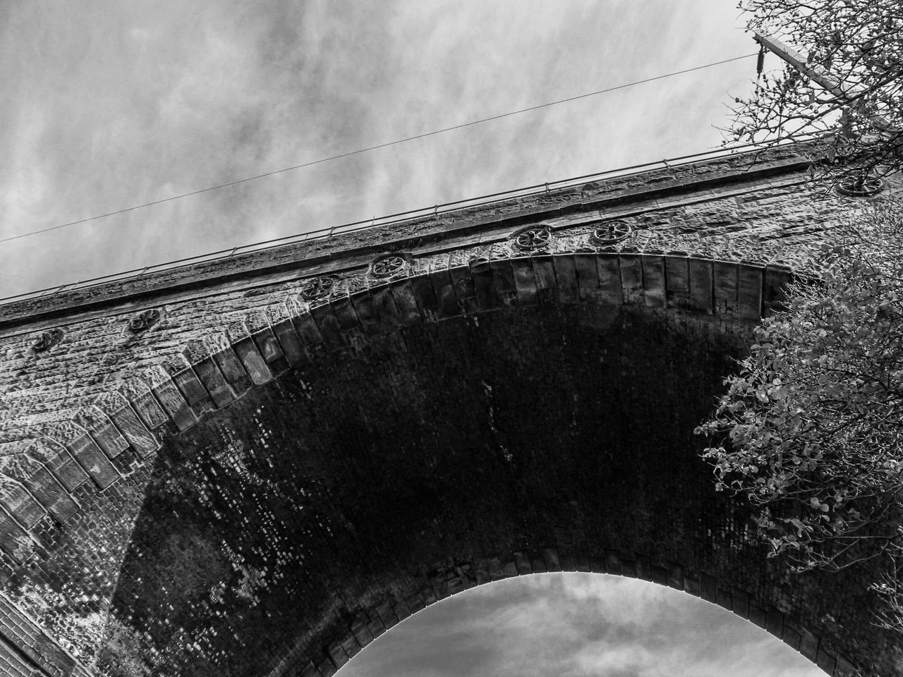 architecture, built structure, arch, day, outdoors, low angle view, connection, bridge - man made structure, sky, no people, cloud - sky, building exterior, nature
