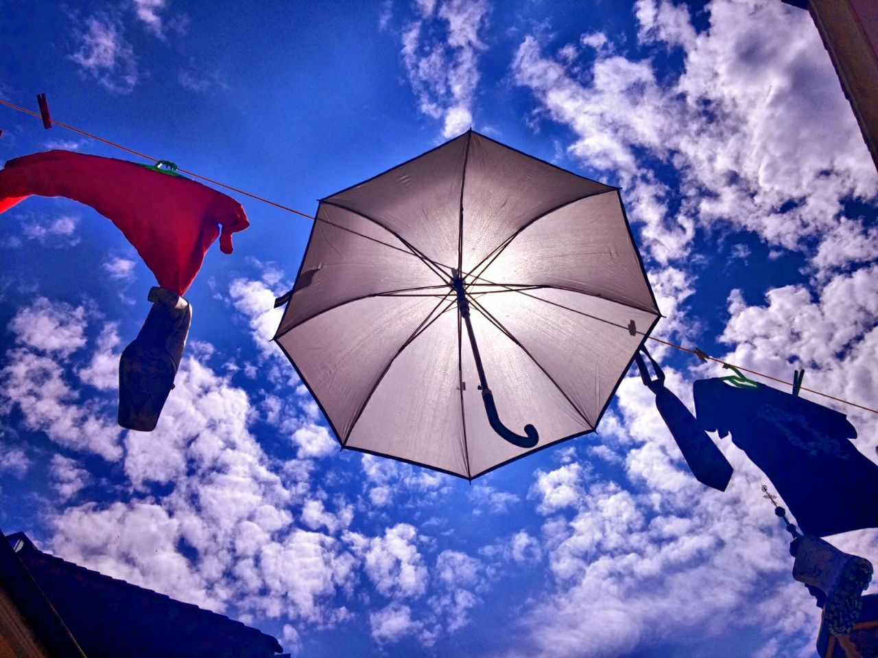 2016-11-06-14-25-14 Blue Clothes Clothes Line Cloud - Sky Day Low Angle View No People Outdoors Shoes Sky Sun Sunlight Umbrella