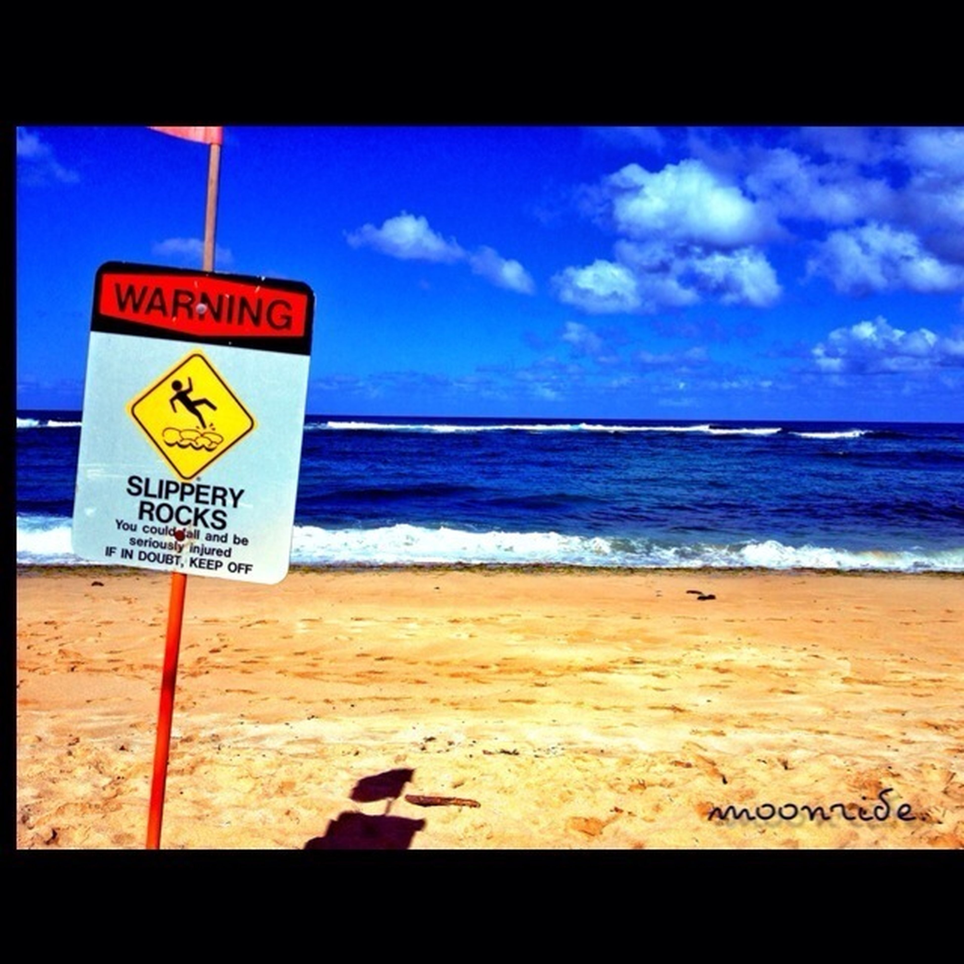 transfer print, sea, horizon over water, beach, auto post production filter, shore, water, sand, sky, text, western script, blue, wave, tranquility, tranquil scene, scenics, warning sign, nature, communication, information sign