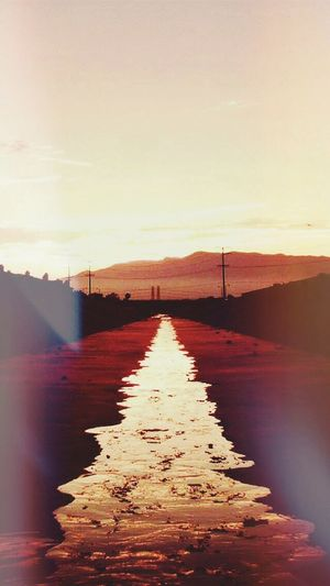 Titled: sunrise over concrete Photoediting Light And Shadow