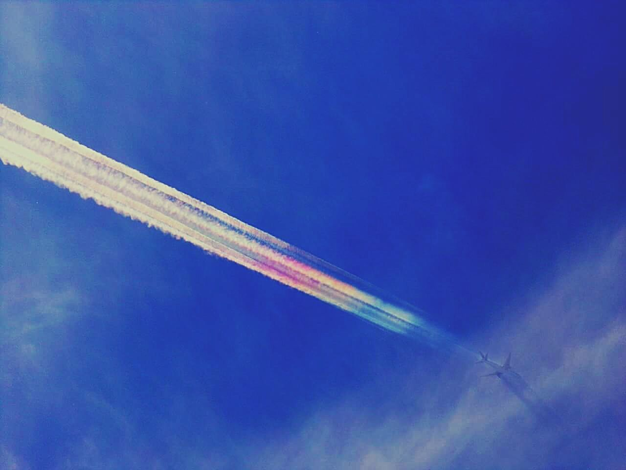 vapor trail, low angle view, airplane, blue, transportation, contrail, flying, air vehicle, sky, journey, no people, day, airshow, outdoors, nature, fighter plane