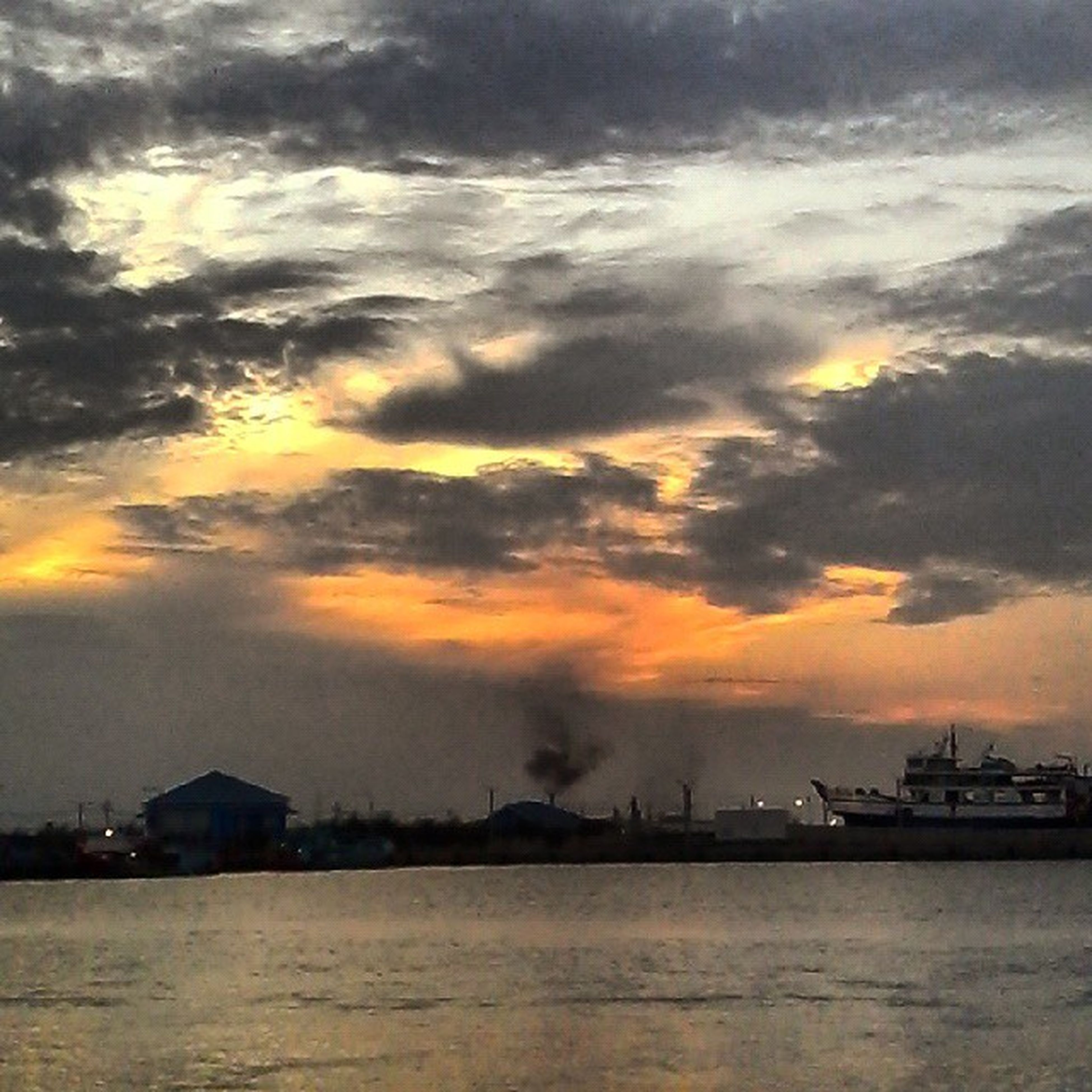 sunset, water, sky, waterfront, sea, cloud - sky, scenics, tranquil scene, beauty in nature, tranquility, cloudy, cloud, nature, nautical vessel, orange color, idyllic, dramatic sky, transportation, silhouette, weather