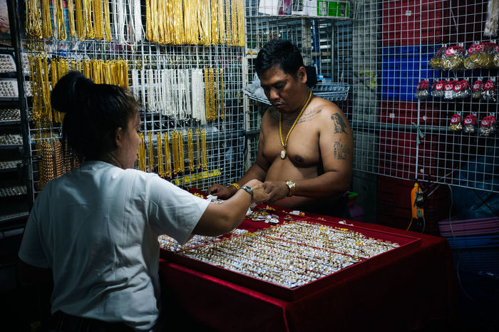 Street Photography in Bangkok, Thailand Bangkok Bargain Bizzare Bracelet Chain Crazy For Sale Funny Gold Jewelry Lovely Market Necklace No Shirt 43 Golden Moments Retail  Rings Silver  Strange Street Photography Streetphoto Tattoos Thai Thailand Weird TCPM